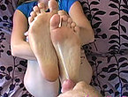 Freaky slut lets a guy cum on her sexy feet